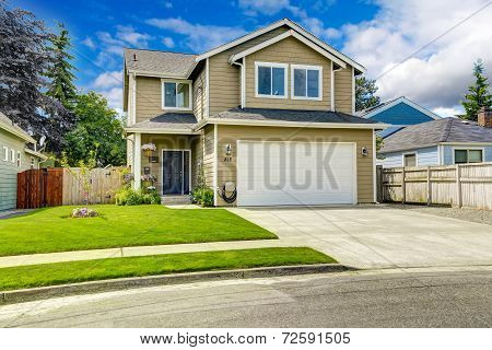 Two Story House Exterior With Front Yard Landscape