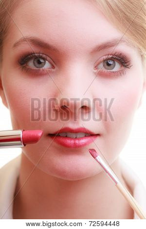 Part Of Face. Woman Applying Red Lipstick With Brush