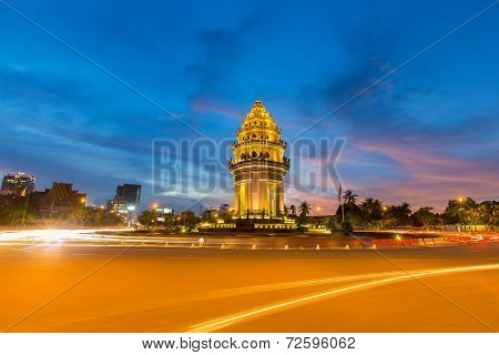 Traffic Drives Around The Independence Monument In Downtown Phnom Penh, Cambodia