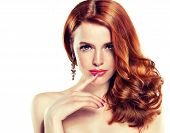 stock photo of hair curlers  - Beautiful girl with long curly red hair - JPG