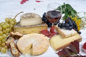 stock photo of fruit platter  - french cheese platter with wine and grapes - JPG