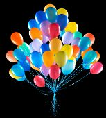 picture of helium  - flying balloons isolated on a black background - JPG