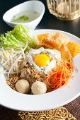 picture of gai  - Gai pad bai gaprow style Thai dish with fried egg and rice noodles - JPG