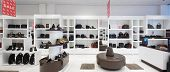 pic of department store  - bright and fashionable interior of shoe store in modern mall - JPG