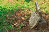 pic of headstones  - Headstone in the cemetery broken in half - JPG