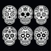 image of sugar skulls  - Vector icon set of decorated skull isolated on black background - JPG