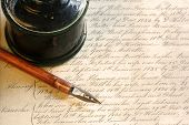 Old-fashioned nib pen and inkwell