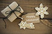 stock photo of ginger bread  - White Happy Weekend on a Label with a Gift and Ginger Bread Cookies on Wood - JPG