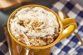 stock photo of latte  - Autumn Pumpkin Spice Latte with Milk and Cream - JPG