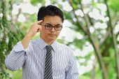 pic of hustler  - Asian businessman is thinking his work in the park