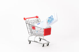 picture of caddy  - Caddy for shopping with money stack on white background - JPG
