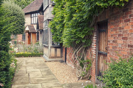image of william shakespeare  - Garden of the cottage where playwright and poet William Shakespeare was born - JPG