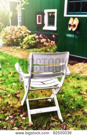 Chair In Autumn Backyard Garden