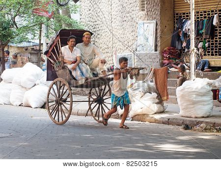 Rickshaw driver working in Kolkata, India.