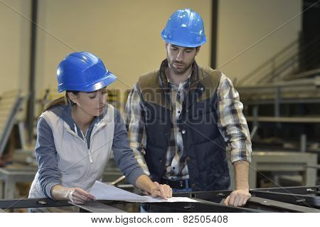 Industrial people meeting together in factory