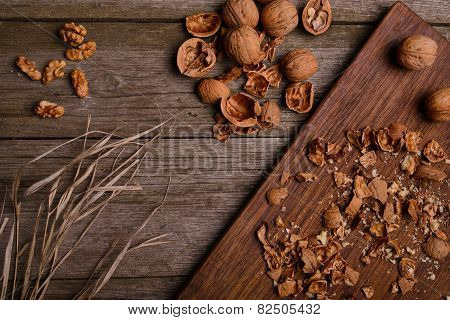 Walnuts On Rustic Wooden Board Background With Straw Copy Space For Text