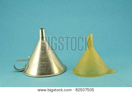 Retro Metal And Plastic Funnel Tool On Blue Background
