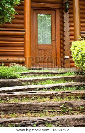step to log home