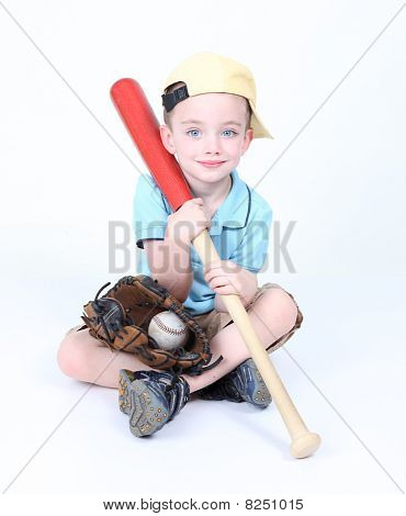 Young Boy Holding A Baseball Bat With Ball And Glove