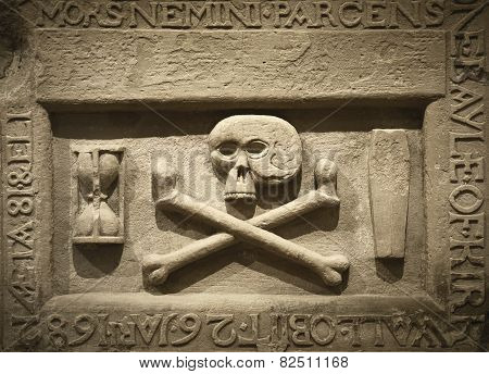 Skull And Cross Bones With Latin Text In A Tomb