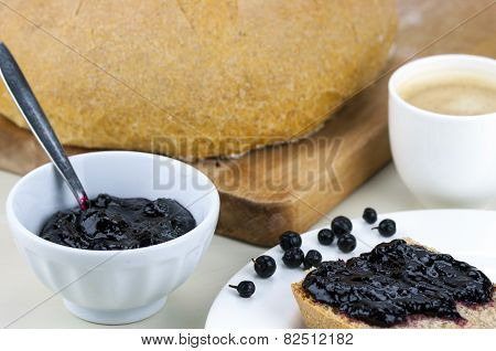 Homemade Blueberry Jam With Integral Bread And Coffe