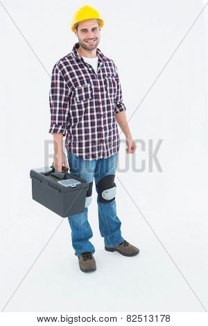Full length portrait of happy male repairman with toolbox on white background