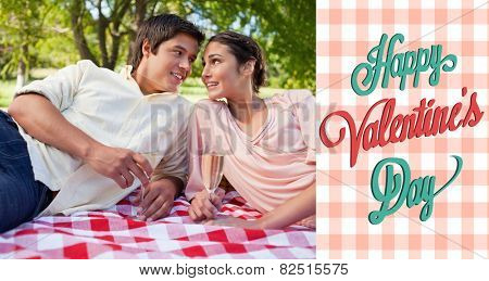 Two friends looking at each other while having a picnic against happy valentines day