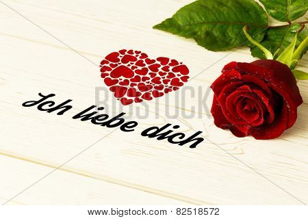ich liebe dich against red rose on wood