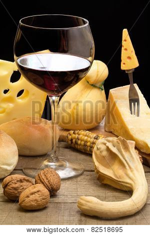 Autumnal Table With Red Wine And Cheese Selection