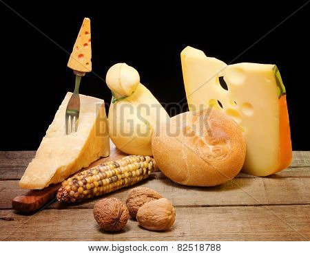 Selection Of Cheese Over Wooden Table