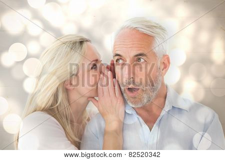 Woman whispering a secret to husband against light circles on bright background