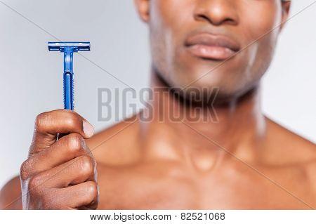 Man Holding Razor Blade.