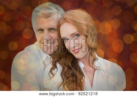Loving couple against close up of christmas lights