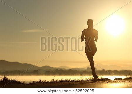 Runner Woman Silhouette Running At Sunset