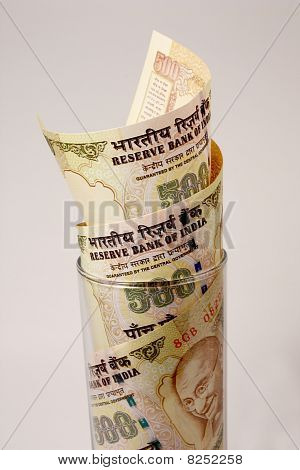 500 Rupee Notes in a Glass showing growth
