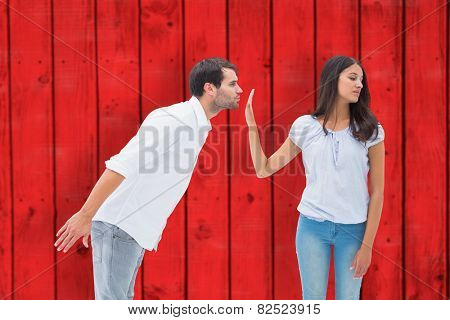 Brunette uninterested in mans advances against red wooden planks