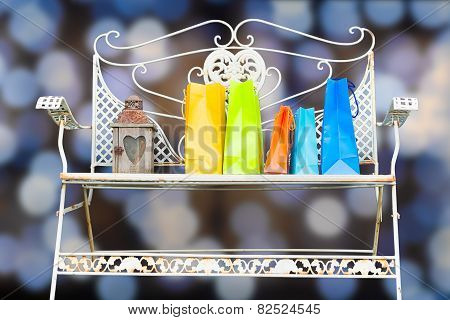 Shopping Bags On The Bench On Abstract Background