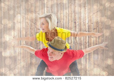 Mature couple joking about together against light glowing dots design pattern