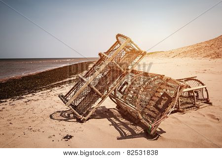 Three lobster traps on Atlantic ocean beach in Prince Edward Island, Canada