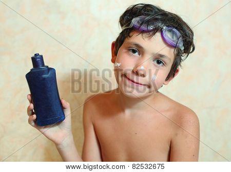 Handsome Preteen Boy With Anti Sunburn Cream