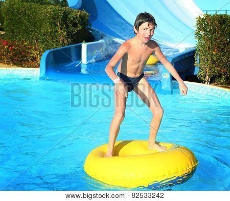 Preteen Little Boy In Open Air Aqua Park