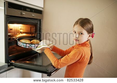 little girl bakes pies at home