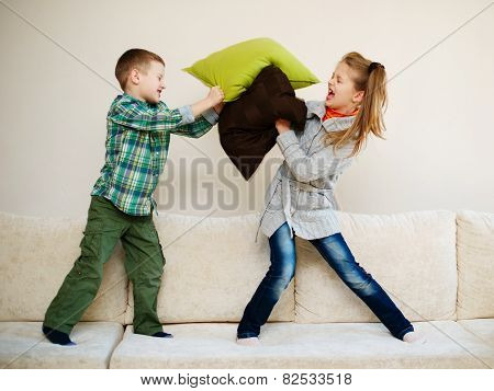 boy fights with girl pillow
