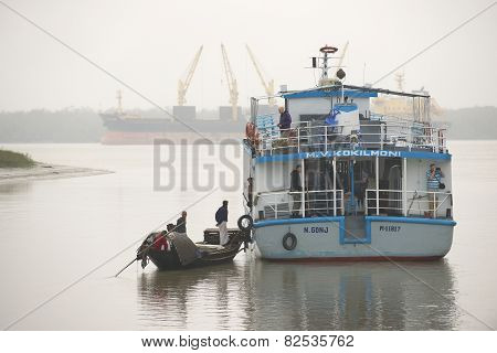 Fishermen talk to the tourist cruise ship personnel in Mongla, Bangladesh.