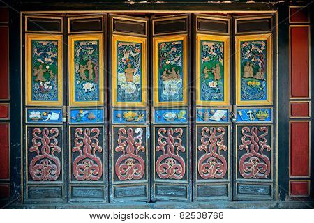 Door with decorations in old street in Lijiang, Yunnan, China.