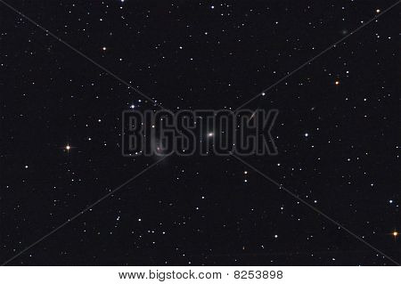 Galaxy Trio In Draco Constellation With Stars Background.