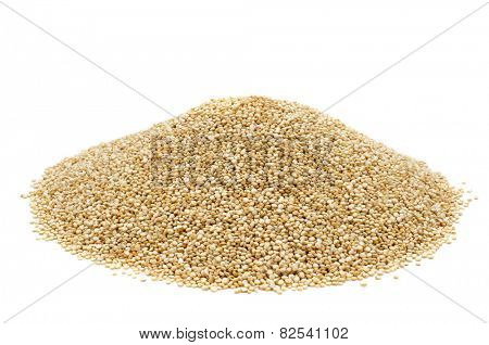 a pile of quinoa seeds on a white background