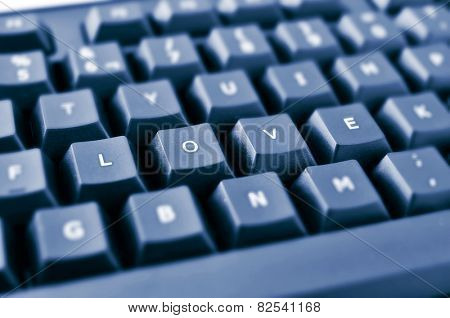 keys of a black keyboard forming the word love