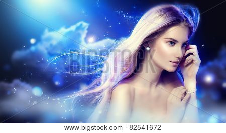 Beauty fantasy girl with long blowing hair over night sky with stars. Fashion Model Portrait. Fairy Glamour Beautiful Woman with Healthy and Beauty Blonde Hair. Flying long hair