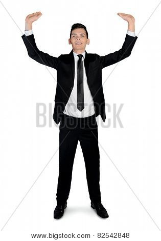 Isolated business man lifting something